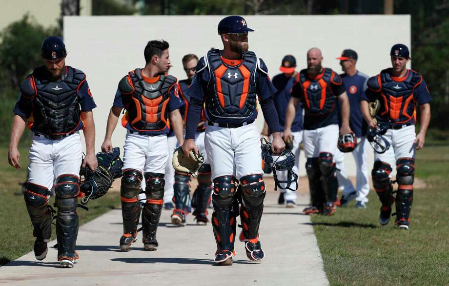 Houston Astros catchers led by Brian McCann (16) walk back from a practice wall during spring training at The Ballpark of the Palm Beaches, Friday, Feb. 16, 2018, in West Palm Beach . Photo: Karen Warren, Houston Chronicle / © 2018 Houston Chronicle