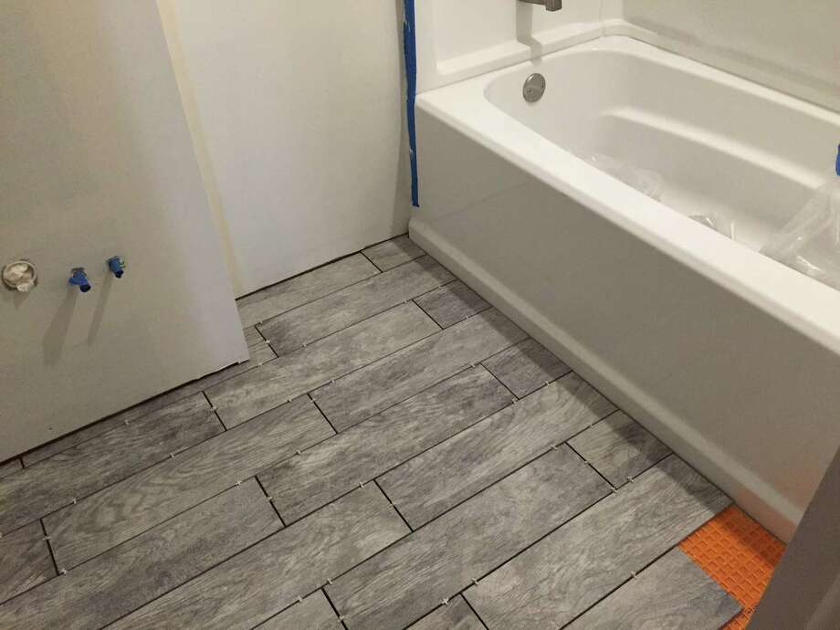 Laying tile may be a more advanced project to do in your home, so be sure you know exactly what you're doing before pursuing. (Amanda Fries / Times Union)