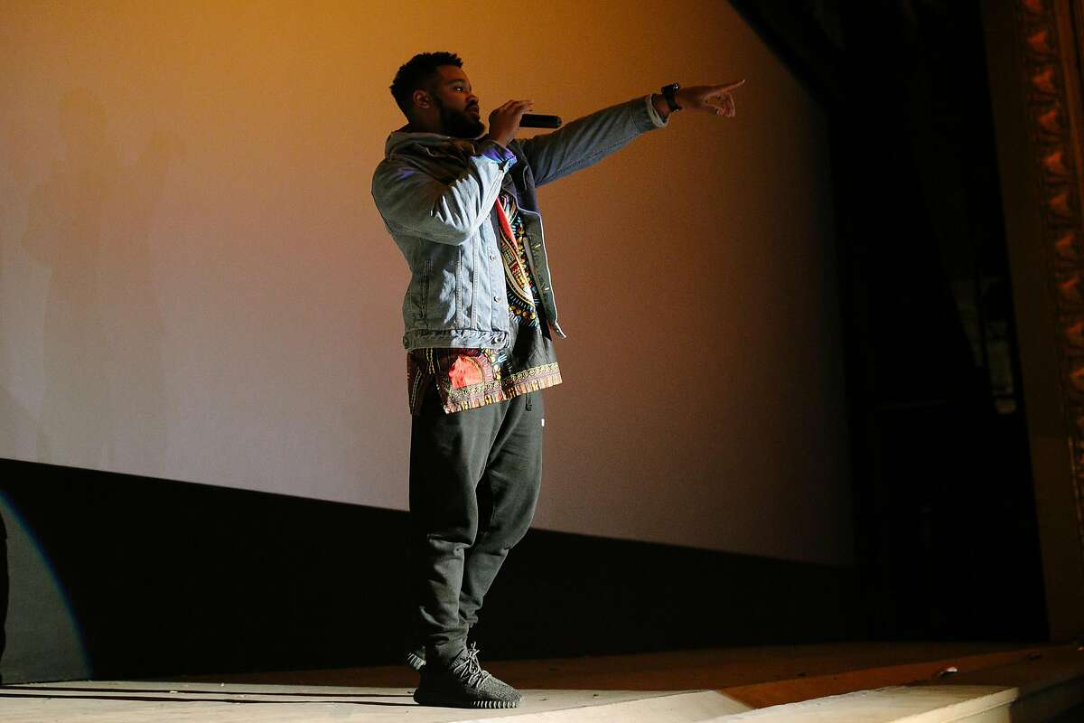 """""""Black Panther"""" director Ryan Coogler, surprises the crowd before the Feb. premiere of Black Panther at Grande Lake Theatre in Oakland, Calif. Following the movie's success, Disney has just announced a $1 million donation for STEM programs around the country."""
