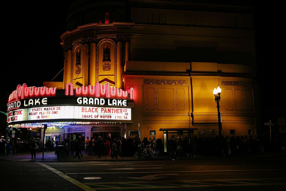 Hundreds of people line up outside to see the premiere of Blank Panther at the Grand Lake Theatre in Oakland, Calif. Thursday, Feb. 15, 2018.