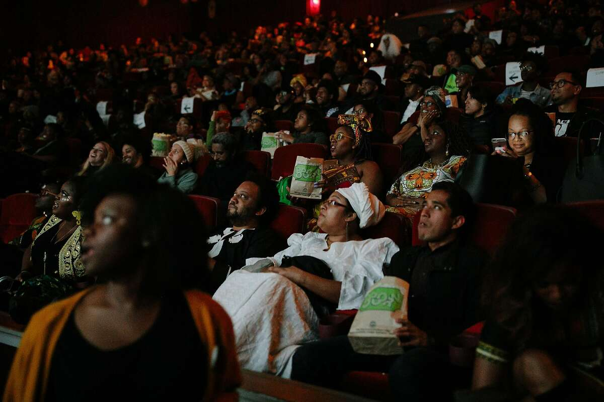 A packed theatre is seen for the premiere of the Black Panther at the Grand Lake Theatre in Oakland, Calif. Thursday, Feb. 15, 2018.