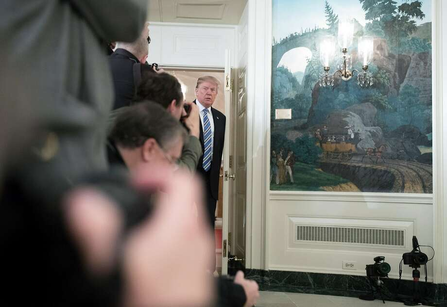 President Trump prepares to give a statement Thursday in the White House on the Florida high school shooting a day earlier. His statement blamed the killings on mental illness, not guns. Photo: TOM BRENNER, NYT