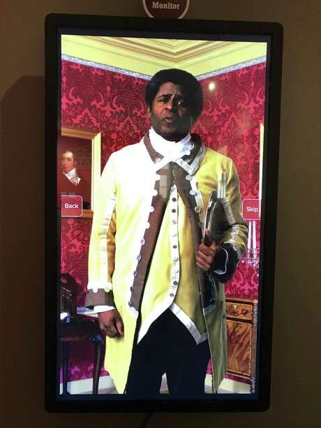 Prince, an enslaved butler at Schuyler Mansion, portrayed in a video at the mansion's visitors' center. (Photo by Amy Biancolli)