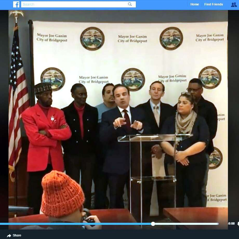 A video posted on Mayor Ganim's facebook page shows him at a new see-through podium. Hizzoner joked that the clear podium was a further example of his administrations' efforts at transparency. Photo: Facebook / Contributed Photo / Connecticut Post Contributed