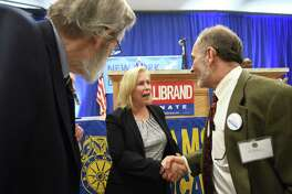 Jay Bellanca, first vice chair of the Washington County Democratic Committee, right, shakes hands with Sen. Kirsten Gillibrand, center, after she accepted the New York State Democratic Committee nomination for re-election to the U.S. Senate on Friday, Feb. 16, 2018, at the Labor Temple in Albany, N.Y. (Will Waldron/Times Union)