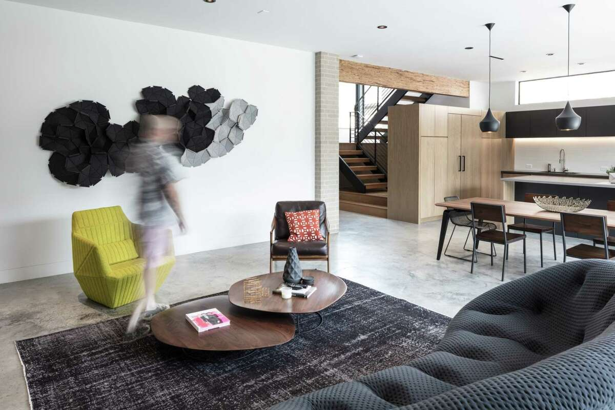 Contemporary furniture from Ligne Roset fills the living room.