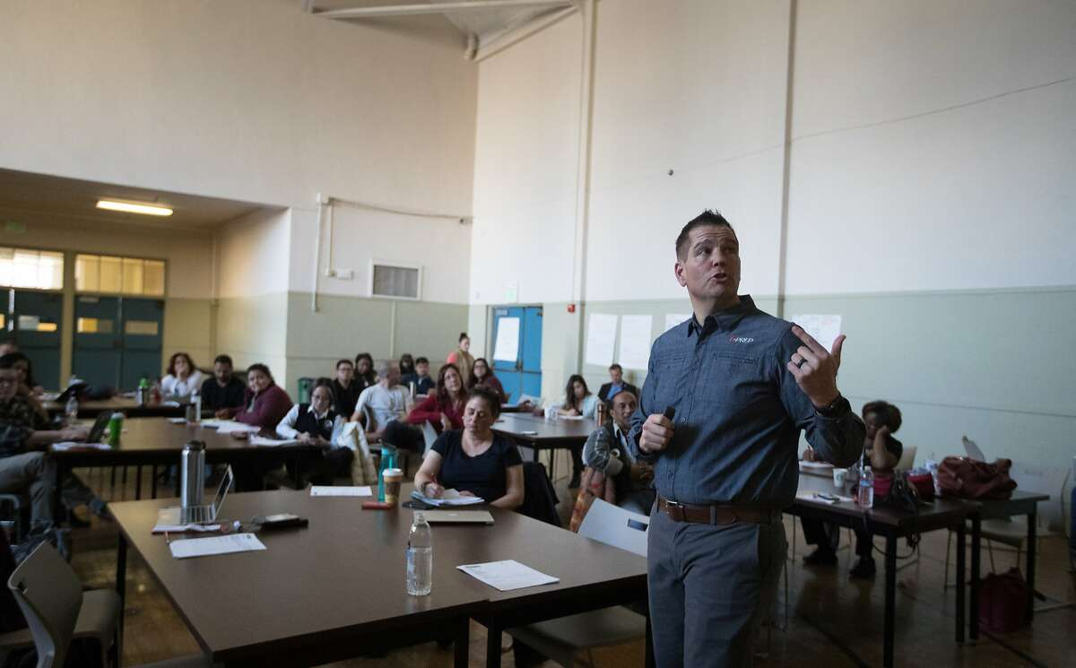 Jeff Solomon of D-Prep trains 52 OUSD employees on how to deal with an active shooter situation by raising awareness of everything from pre-incident indicators and characteristics of active shooters to how active shooters typically choose their targets and what to do immediately after an incident begins on campus on Friday, Feb. 16, 2018 in Oakland, CA.