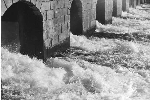 Water flows through the  Moccasin Power House, generating electricity. The flow of water here is 580,000,000 gallons a day. October 26, 1934  Associated Press photo