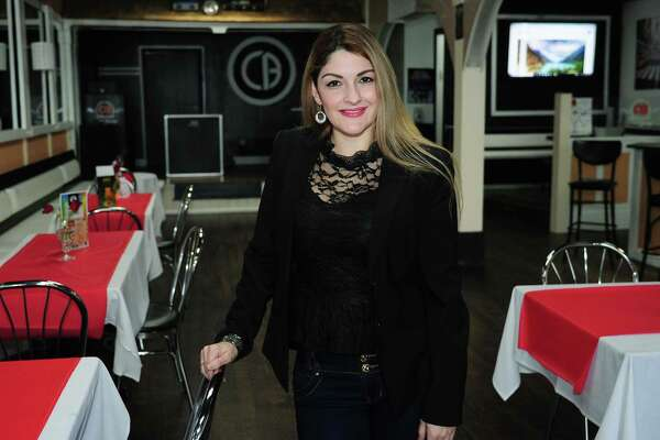 CB Restaurant & Lounge owner Diana Londono, in her new restaurant Thursday, February 15, 2018, in Norwalk, Conn. Londono hopes CB Restaurant & Lounge will do well amid continued revitalization of the Wall Street area.
