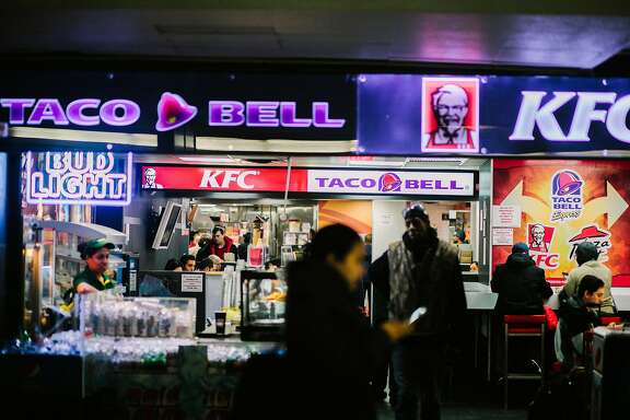 Customers at a Taco Bell in New York, Feb. 15, 2018. Brian Niccol, who as the chief executive of Taco Bell reversed the chain�s fortunes, will apply his successes to Chipotle, which has struggled with a plunging stock price and a string of health issues that have hurt its image. (John Taggart/The New York Times)