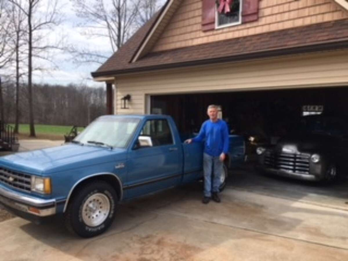 Larry Jones of Statesville, N.C., stands next to his Chevrolet S-10 pick-up truck, which was used to film a commercial with Dale Earnhardt, Jr. Jones, who was a long-times resident of Latham, N.Y. is going to keep the truck, which has been autographed by Earnhardt. (Courtesy of Larry Jones)
