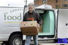 Mike Greene delivers food from local grocery stores to the Jericho Partnership Food Pantry on Spring Street, Friday, Feb. 16, 2018.