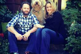 Eric Story and Alison Smith-Story, with their goldendoodle, Lord Sandwich.