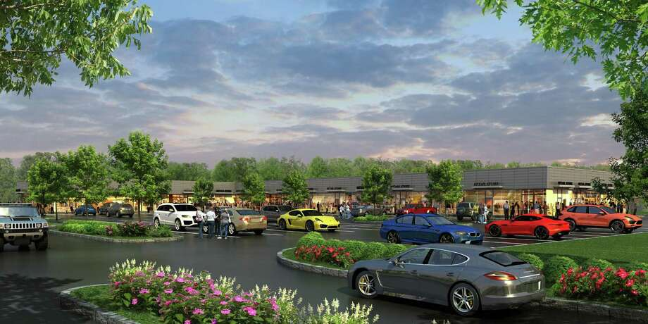 A artists rendering of the proposed shopping center at 899 Bridgeport Avenue in Shelton, Conn. R.D. Scinto plans to build the 26,200 square foot shopping center on roughly three acres of land at 899-905 Bridgeport Avenue. Photo: Contributed Photo / Contributed Photo / Connecticut Post Contributed