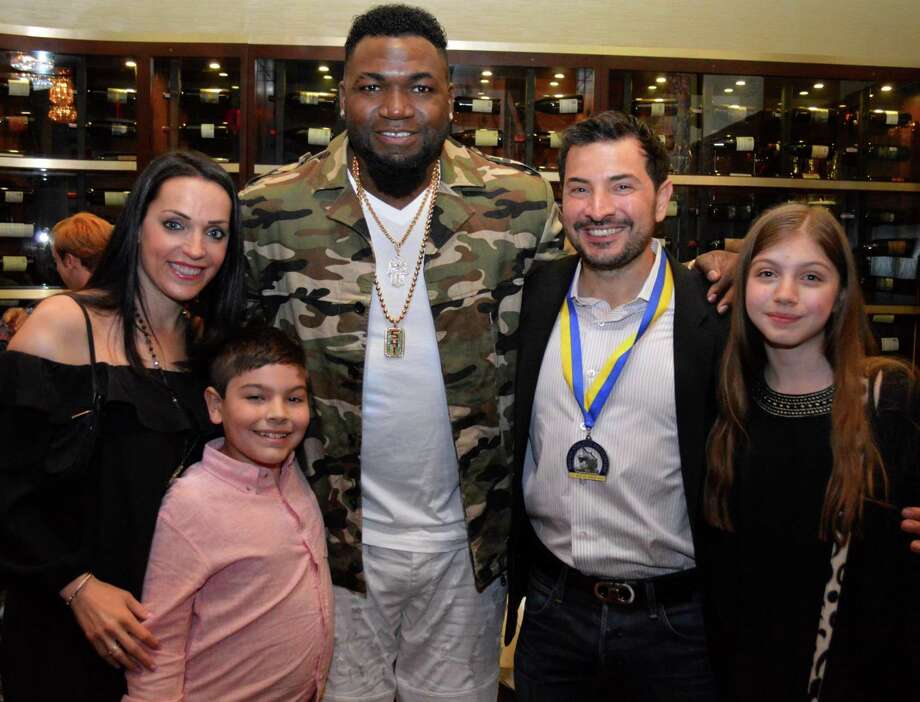From left to right, Devynne Tortora, Sergio Tortora, Jr., David Ortiz, SergioTortora, Alexa Tortora after the 2017 Boston Marathon. Sergio Tortora is running to benefit Ortiz's nonprofit. Photo: Contributed