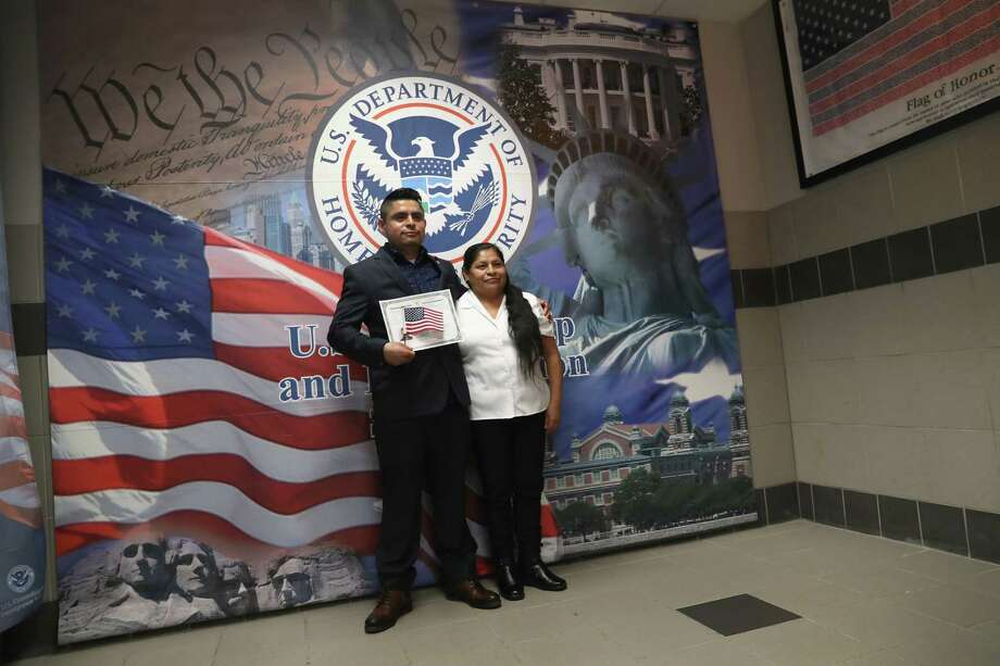 NEW YORK, NY - FEBRUARY 02:  A Mexican immigrant poses for photos with his mother while holding a U.S. citizenship certificate at a naturalization ceremony on February 2, 2018 in New York City. U.S. Citizenship and Immigration Services (USCIS) swore in 128 immigrants from 42 different countries during the ceremony at the downtown Manhattan Federal Building. Photo: John Moore, Getty Images / 2018 Getty Images