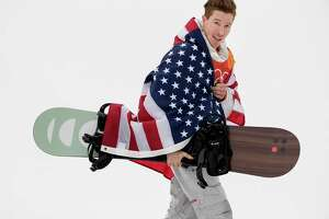 Shaun White celebrates after winning the gold medal in the Men's Half Pipe Snowboard finals at Phoenix Park in South Korea on Wednesday, Feb. 14, 2018, during the Pyeongchang Winter Olympics.