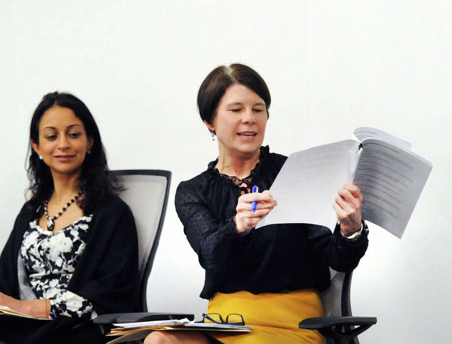 """At right, Carolyn Treiss of the Connecticut Department of Labor, makes a point about pay equity for women as fellow panelist Dita Bhargava of Greenwich, a former Wall Street trader and Democrat who is considering a run for governor, listens after the screening of the film """"Battle of the Sexes"""" featuring the life story of tennis great Billie Jean King's 1973 matchup with Bobby Riggs at Fairfield County's Community Foundation in Norwalk, Conn., Thursday night, Feb. 15, 2018. Photo: Bob Luckey Jr. / Hearst Connecticut Media / Greenwich Time"""