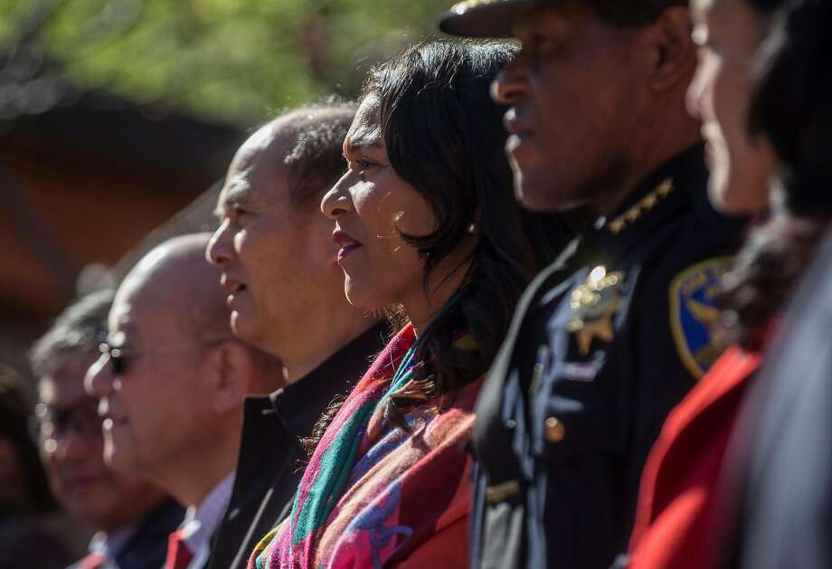 San Francisco Board of Supervisors President London Breed (center) stands onstage with city officials in Portsmouth Square. Photo: Jessica Christian, The Chronicle