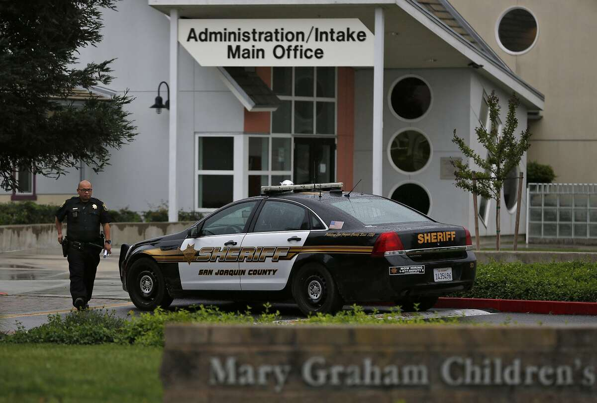 A San Joaquin County Sheriff's deputy walks back to his car after responding to a call to Mary Graham Children's Shelter April 6, 2017 in French Camp, Calif. A new bill would limit arrests at foster children's shelters in California.