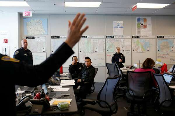 Commander David Lazar (hand at left) talks in a multi-department meeting at the San Francisco Department of Emergency Management  in San Francisco, Calif., on Wednesday, February 14, 2018.