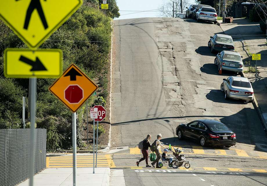 A car approaches a potholed section of Harold Street in Oakland. A bond to repair roads has little public scrutiny. Photo: Noah Berger, Special To The Chronicle