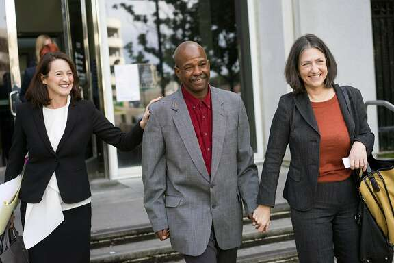 Glenn Payne is lead out of the Hall of Justice in San Jose, Calif. by members of the Northern California Innocence Project on Friday, Jan. 26, 2018. Payne served 13 years in prison for child molestation, but the Northern California Innocence Project helped get that conviction thrown out.