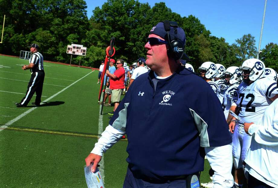 Wilton Head Coach: Bruce Cunningham during football action against Fairfield Warde in Fairfield, Conn. on Saturday Sept. 23, 2017. Photo: Christian Abraham / Hearst Connecticut Media / Connecticut Post