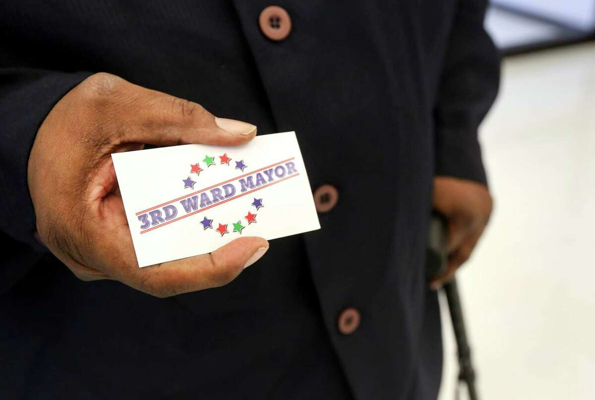 """Ed Banks, who is known as the """"Mayor of Third Ward,"""" shows off his business card, at the Third Ward Multi-Service Center, Monday, Nov. 21, 2016, in Houston."""