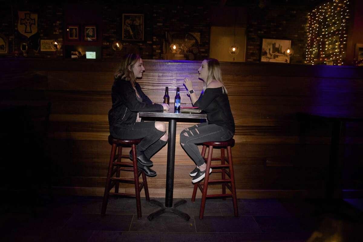 Emma Hauser, of Carmel, NY, left, and Ashley Conklin, of Brewster, NY, both 21, at Molly Darcy's, in Danbury, Conn, on Thursday night, February 15, 2018.