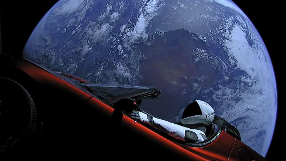 This image from SpaceX shows the company's spacesuit in Elon Musk's red Tesla sports car which was launched into space during the first test flight of the Falcon Heavy rocket on Tuesday, Feb. 6, 2018. (SpaceX) Photo: SpaceX / TNS / San Jose Mercury News