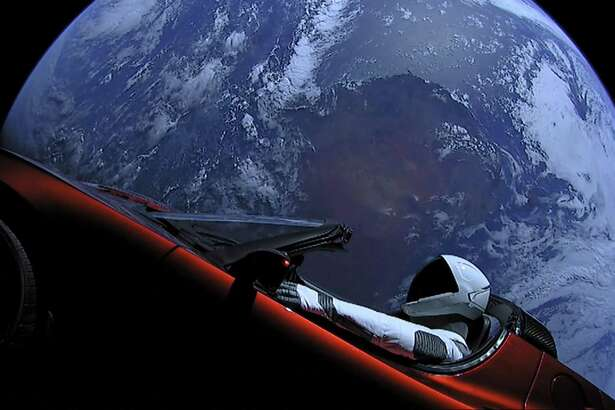 This image from SpaceX shows the company's spacesuit in Elon Musk's red Tesla sports car which was launched into space during the first test flight of the Falcon Heavy rocket on Tuesday, Feb. 6, 2018. (SpaceX)