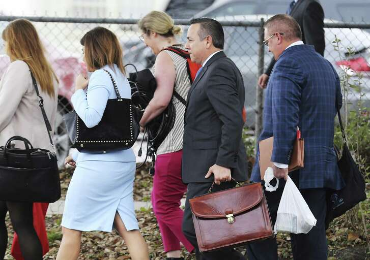State Sen. Carlos Uresti (second from right) leaves the John H. Wood Federal Courthouse on Friday, Feb. 16, 2018. Senior U.S. District Judge David Ezra postponed closing arguments in the criminal trial of state Sen. Carlos Uresti and co-defendant Gary Cain until Tuesday, handing the jury its instructions for deliberations before recessing for the holiday weekend. Closings were expected today, but arguments over instructions for the jury delayed proceedings, and the court is closed Monday for President's Day. (Kin Man Hui/San Antonio Express-News)