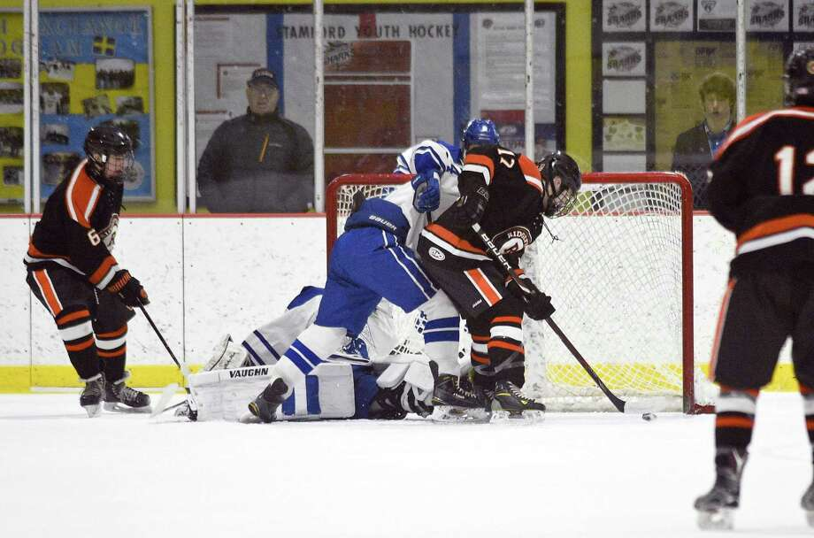 Ridgefield's Kieran McGowan (17) scores in the first period against Darien during an FCIAC Boys Ice Hockey game at Terry Conners Rink on Friday, Feb. 16, 2018 in Stamford, Connecticut. Ridgefield defeated Darien 5-3. Photo: Matthew Brown / Hearst Connecticut Media / Stamford Advocate