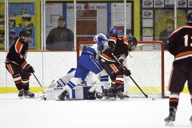 Ridgefield's Kieran McGowan (17) scores in the first period against Darien during an FCIAC Boys Ice Hockey game at Terry Conners Rink on Friday, Feb. 16, 2018 in Stamford, Connecticut. Ridgefield defeated Darien 5-3.