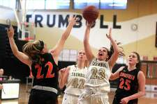 Trumbull's Julie Keckler attempts a shot as Ridgefield's Caroline Curnal defends during girls basketball action in Trumbull, Conn., on Saturday Jan. 20, 2018.