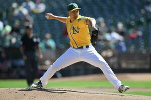 OAKLAND, CA - SEPTEMBER 27:  Kendall Graveman #49 of the Oakland Athletics pitches against the Seattle Mariners in the top of the first inning at Oakland Alameda Coliseum on September 27, 2017 in Oakland, California.  (Photo by Thearon W. Henderson/Getty Images)