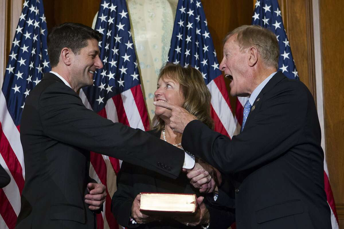 House Speaker Paul Ryan of Wis. shares a laugh with Rep. Paul Cook, R-Calif., during a mock swearing in ceremony on Capitol Hill in Washington, Tuesday, Jan. 3, 2017, as the 115th Congress began. (AP Photo/Jose Luis Magana)
