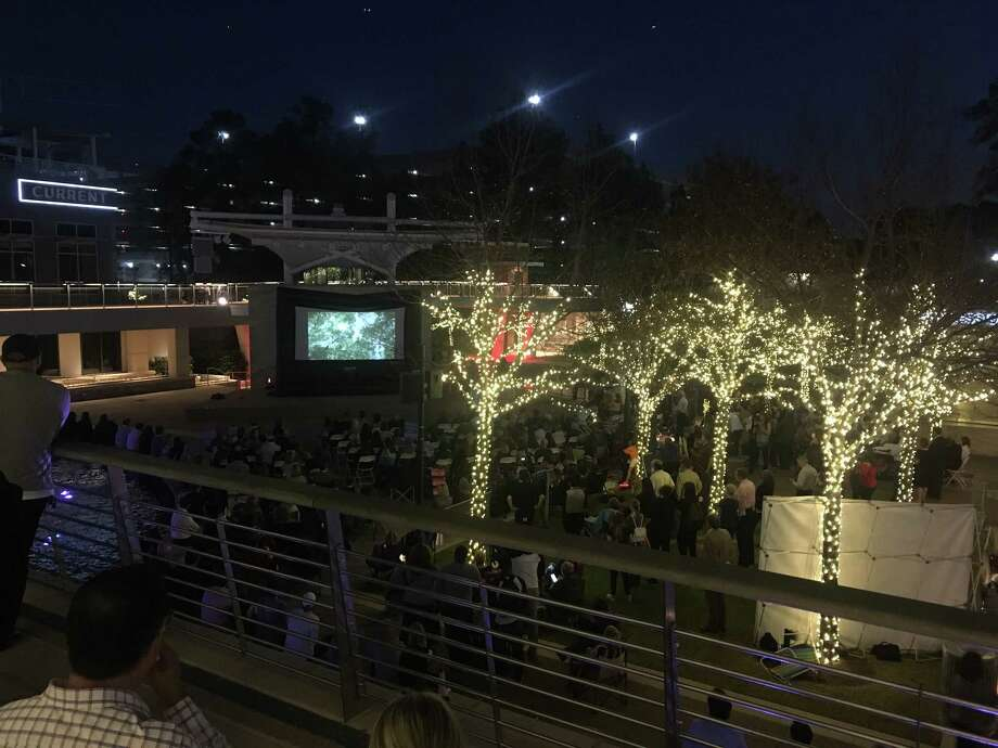 The Inspire Film Festival kicked off Thursday night with the short films viewing on The Woodlands Waterway. A large crowd gathered around a temporary screen to watch and be inspired by 15-20 minute documentaries. Photo: Patricia Dillon