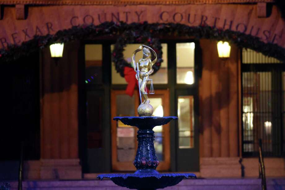 The Lady Justice statue atop a fountain in front of the Bexar County Courthouse gleams after being refurbished by artist Gilbert E. Barrera last year. Arguably, the interests of justice are not served by secrecy about bad judges. Photo: Billy Calzada / / San Antonio Express-News