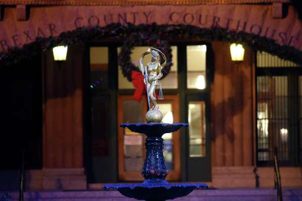 The Lady Justice statue atop a fountain in front of the Bexar County Courthouse gleams after being refurbished by artist Gilbert E. Barrera last year. Arguably, the interests of justice are not served by secrecy about bad judges.