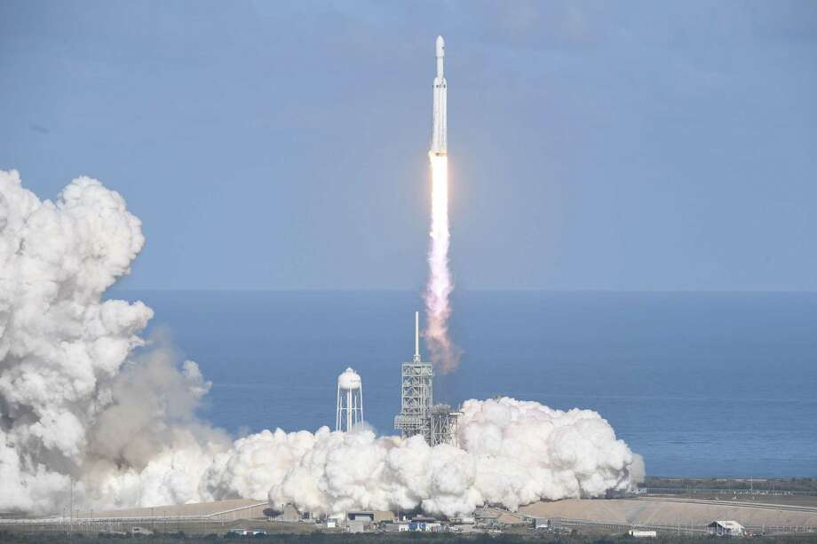 The SpaceX Falcon Heavy takes off from Pad 39A at the Kennedy Space Center in Florida, on Feb. 6 on its demonstration mission. The world's most powerful rocket, SpaceX's Falcon Heavy, blasted off on its highly anticipated maiden test flight, carrying CEO Elon Musk's cherry red Tesla roadster to an orbit near Mars. Photo: JIM WATSON /AFP /Getty Images / AFP or licensors