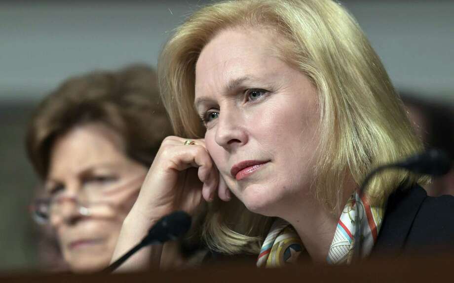 Sen. Kirsten Gillibrand, D-N.Y., right, has called for the resignation of President Donald Trump over allegations of sexual misconduct. But that's not going to happen — voters were well aware of his conduct and still elected him. Photo: Susan Walsh /Associated Press / Copyright 2018 The Associated Press. All rights reserved.