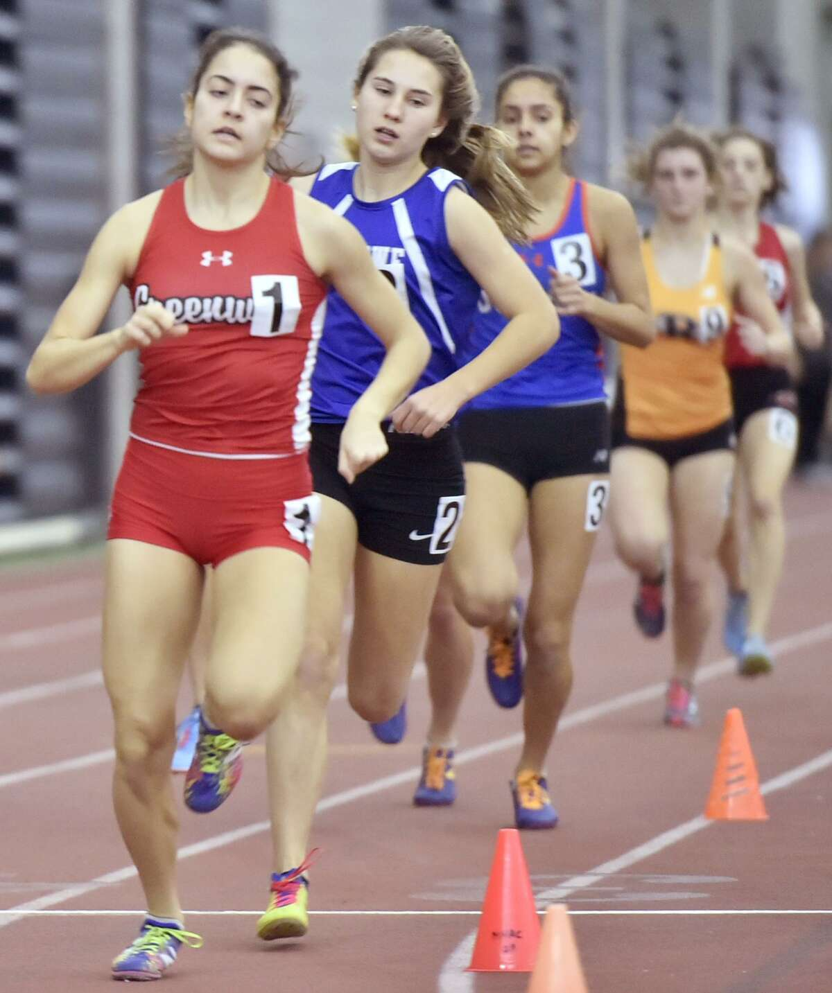 New Haven, Connecticut - Saturday, February 10, 2018: Girls 1000 meter run winner Emily Philippides of Greenwich H.S., left, runs ahead of eventual third place winner Alyssa Kraus of Fairfield-Ludlowe H.S. during the 2018 State Class LL Girls and Boys Indoor Track and Field Championship at the Floyd Little Athletic Center in New Haven .
