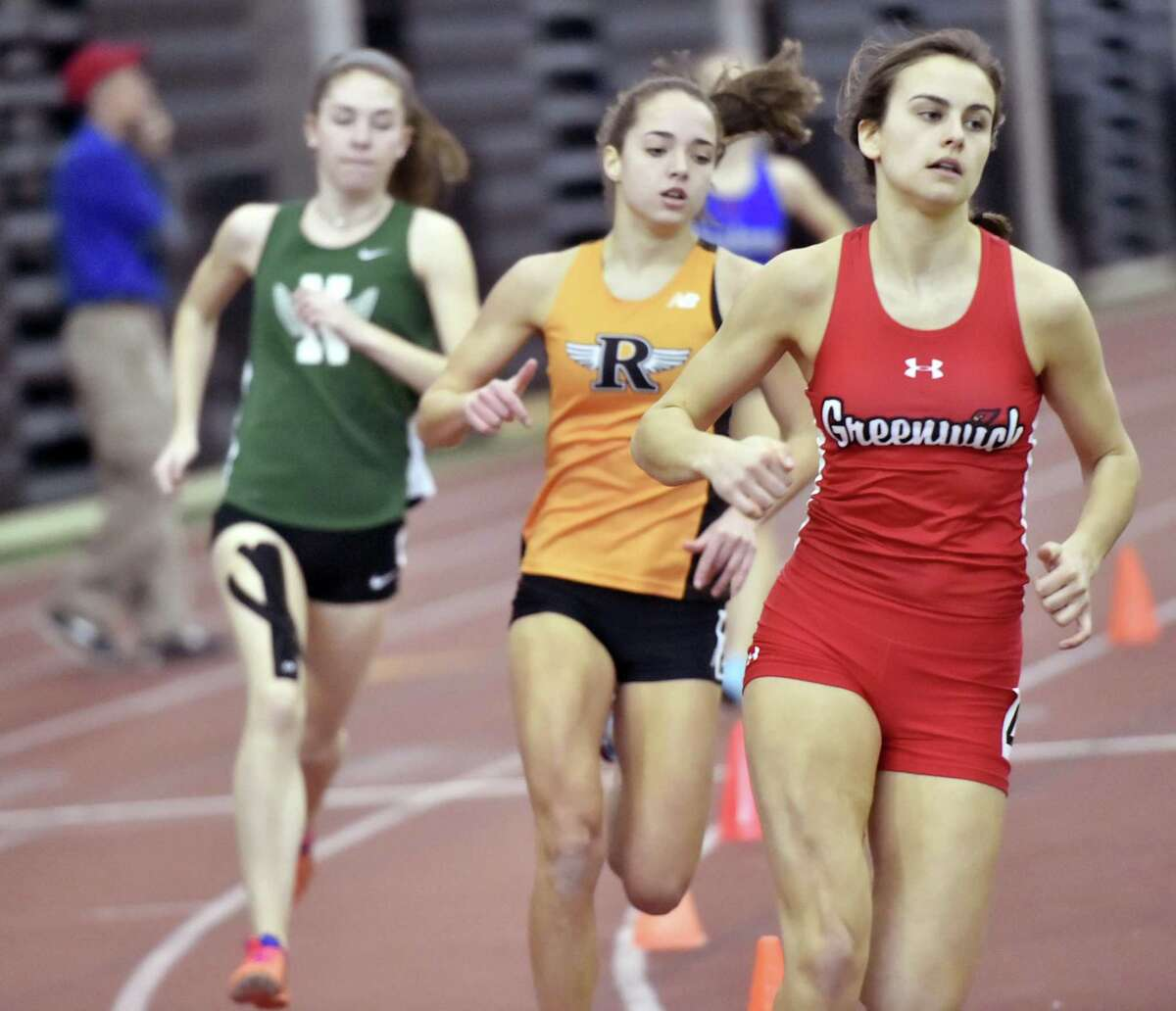 New Haven, Connecticut - Saturday, February 10, 2018: Genevieve DeWinter of Greenwich H.S. runs to a first place finish in the girls 600 Meter Race, right, as Emma Langis of Ridgefield H.S., center finishes second followed in third by Laura Turner of Norwalk H.S., left, during the 2018 State Class LL Girls and Boys Indoor Track and Field Championship at the Floyd Little Athletic Center in New Haven .