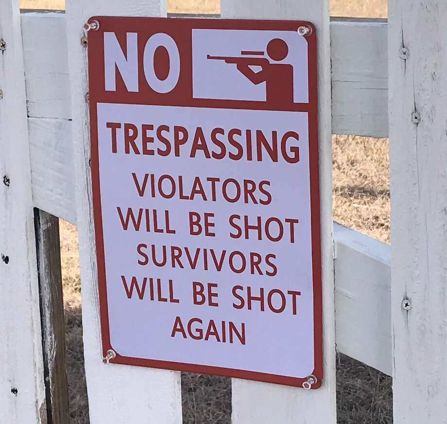 William Shelton placed a sign warning surveyors for Texas Central Partners to stay off his property, seen here Jan. 31 outside Teague, Texas.
