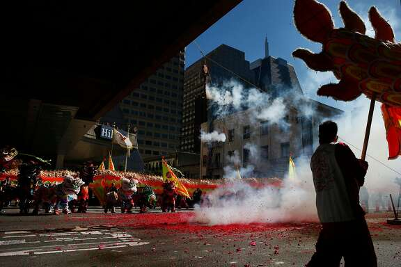The Lunar New Year parade kicked outside Portsmouth Square in Chinatown with firecrackers, Friday, Feb. 16, 2018, in San Francisco, Calif.