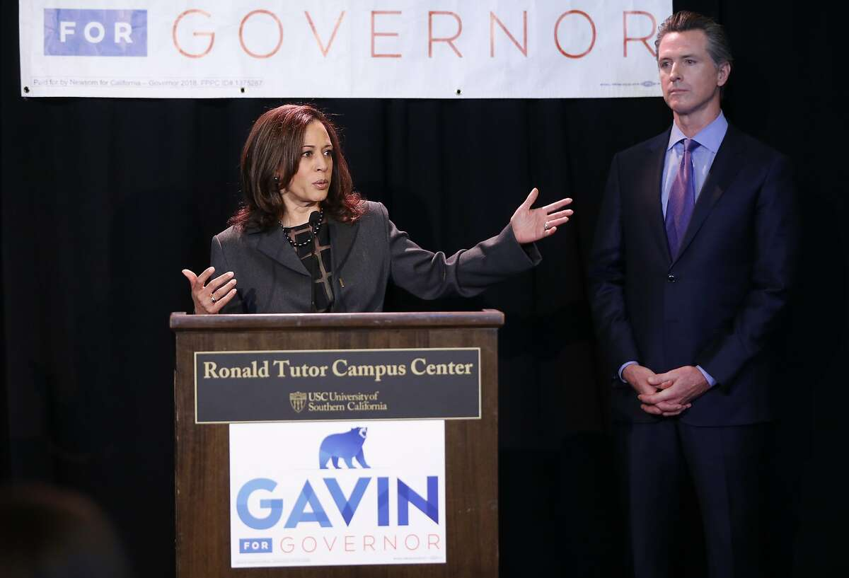 FILE PHOTO: Sen. Kamala Harris, left, endorses California Lt. Gov. Gavin Newsom, right, for the 2018 California Governor's race at the Ronald Tutor Campus Center at the University of Southern California in Los Angeles on Friday, Feb. 16, 2018. Newsom would appoint Harris' replacement in the U.S. Senate if she becomes the next vice president.