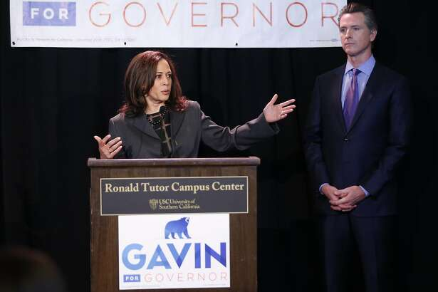 Sen. Kamala Harris, left, endorses California Lt. Gov. Gavin�Newsom, right, for the 2018 California Governor's race at the Ronald Tutor Campus Center at the University of Southern California in Los Angeles on Friday, Feb. 16, 2018. (AP Photo/Damian Dovarganes)
