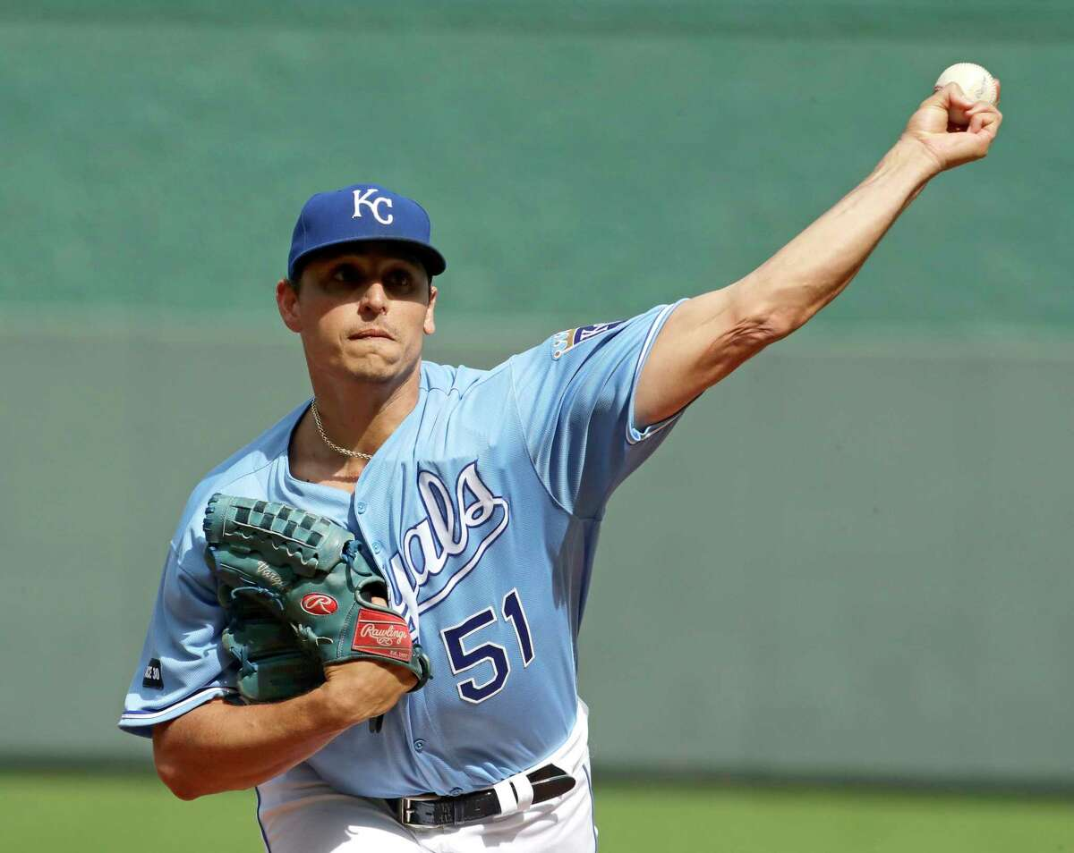 FILE- In this Oct. 1, 2017, file photo, Kansas City Royals starting pitcher Jason Vargas throws during the first inning of a baseball game against the Arizona Diamondbacks in Kansas City, Mo. A person familiar with the deal said Friday, Feb. 16, 2018, that Vargas and the New York Mets have agreed to a $16 million, two-year contract, adding depth to a New York rotation that's been riddled by injuries the past two seasons. (AP Photo/Charlie Riedel, File)